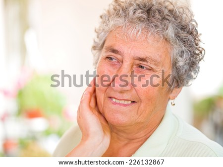 Close up photo of a happy elderly woman
