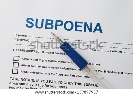 Close up picture of  Subpoena with pen.
