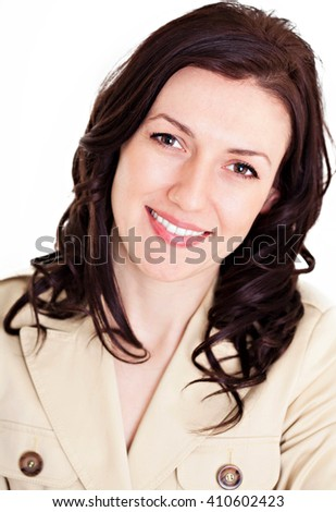 Close up portrait of a beautiful young professional woman with a gentle smile.