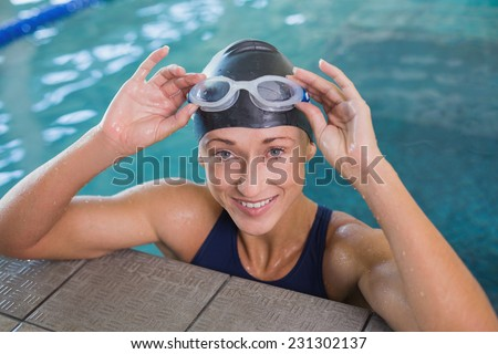 Close up portrait of a fit female swimmer in the pool at leisure center