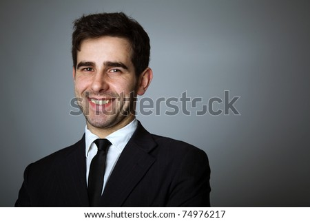 Close-up portrait of a handsome young business man