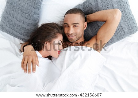 young loving couple bed stock photo 439573801 shutterstock. Black Bedroom Furniture Sets. Home Design Ideas