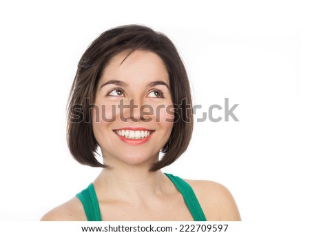 Close-up portrait of a young smiling woman looking up, isolated on white