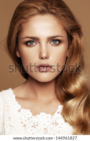 Close-up portrait of beautiful woman with nude make-up