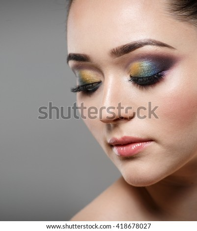 Close up portrait of beautiful young woman face. Makeup concept.