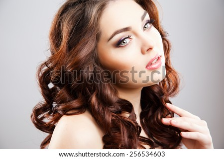 Close-up portrait of beautiful young woman with perfect make-up and hair-style