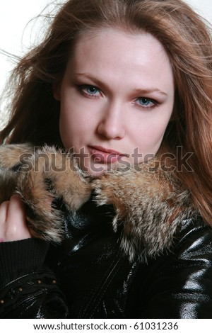 Close-up portrait of girl in furs