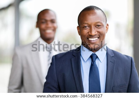 close up portrait of happy african businessman
