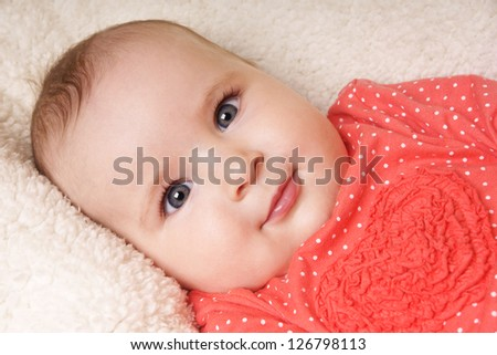 Close-up portrait of happy beautiful smiling newborn baby girl, studio shot