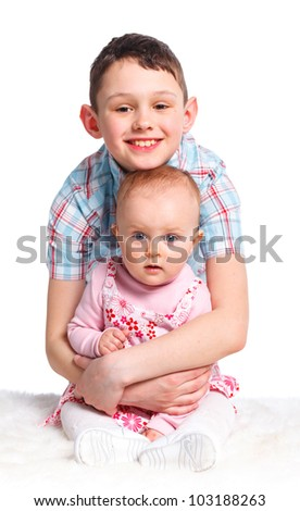 Close-up portrait of happy children in studio. Brather and sister looking at camera, isolated on white background.
