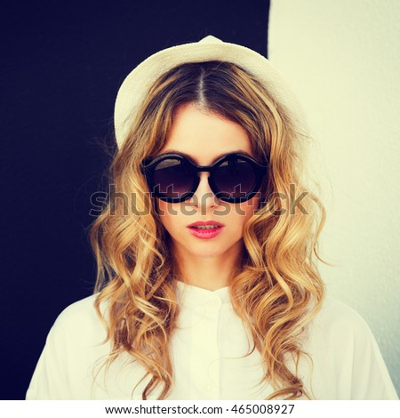 Close Up Portrait of Hipster Girl in Hat and Sunglasses on Contrast Black and White Wall Background. Urban Fashion Woman Outdoors in Summer. Street Style. Square Toned Instagram Styled Photo.