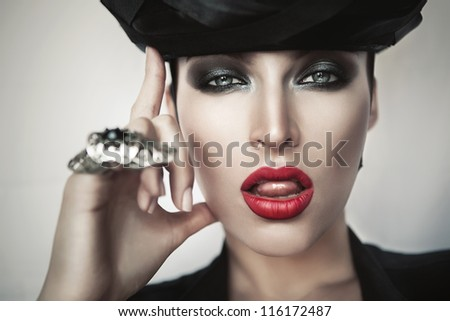 close-up portrait of hot woman in black hat
