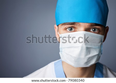 close up portrait of medical doctor in mask with copy space