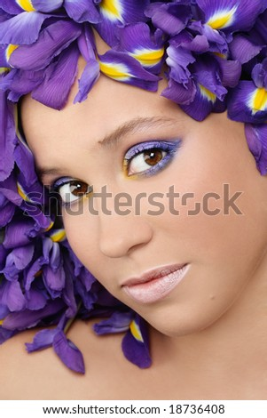 Close-up portrait of pretty young girl in blue iris