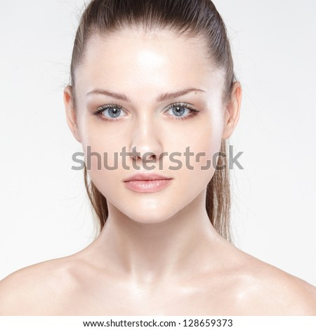 Close-up portrait of sexy caucasian young woman with beautiful blue eyes. On white background