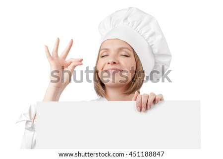 close up portrait of smiling female chef, cook or baker making tasty gesture and peeking over edge of banner with empty copy space for you text isolated on white background. advertisement blank board