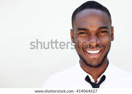 Close up portrait of smiling handsome young african man on white background