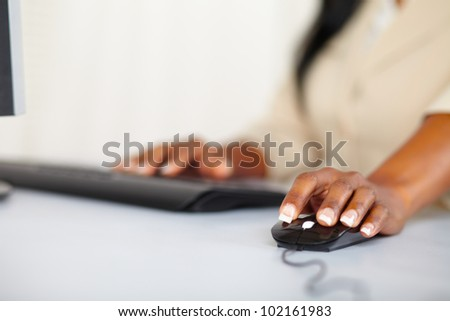 Close up portrait of the hands of a young woman using a computer