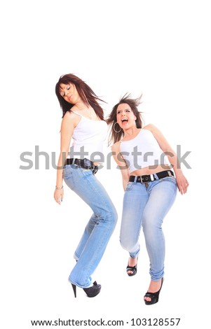 Close-up portrait of two girls in jeans and white tshirt on white background
