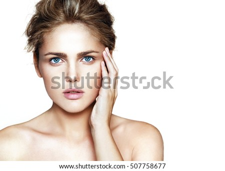 Close-up portrait of young beautiful woman isolated on white background
