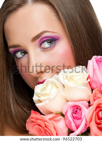 Close-up portrait of young beautiful woman with stylish bright make-up with roses