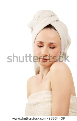 Close-up portrait of young woman after bath - isolated on white background