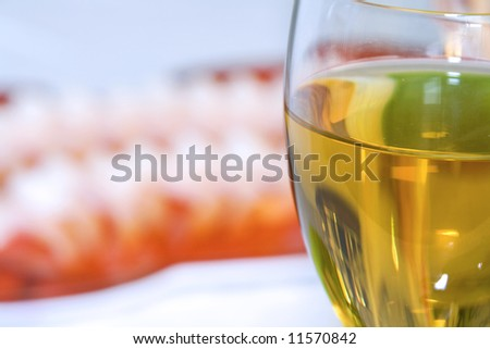 Close up - Shrimps on a Plate with the Wine Glass in Focus