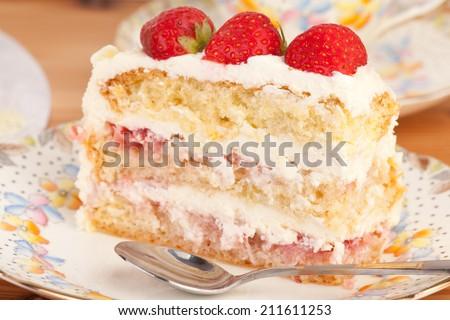 close up slice of strawberry and mascarpone cake on the plate