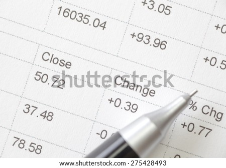 Close - up Stock market data chart and pen