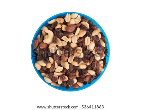 Close-up top view mix different of nuts and dried fruits isolated
