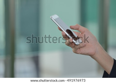 Close up Touch screen mobile phone, in hand