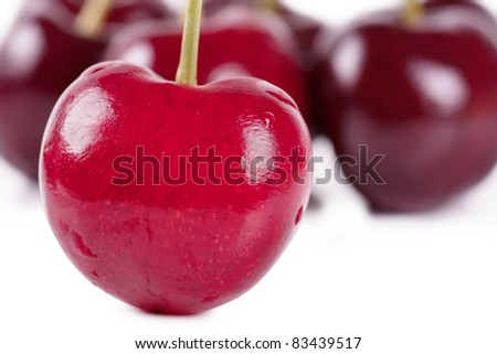 Close up view of heart shaped cherry and some cherries on background