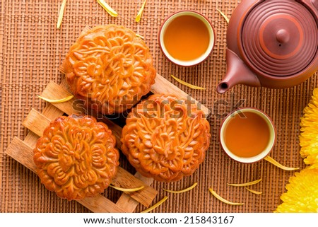Close up view of Moon cake and tea pot. Chinese mid autumn festival food. Above angle