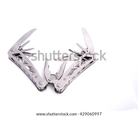Close up view of stainless steel multi-tool pliers, pocket knife, survival tools isolated on white background. Multiple purposes and variation tools concept with copy space.