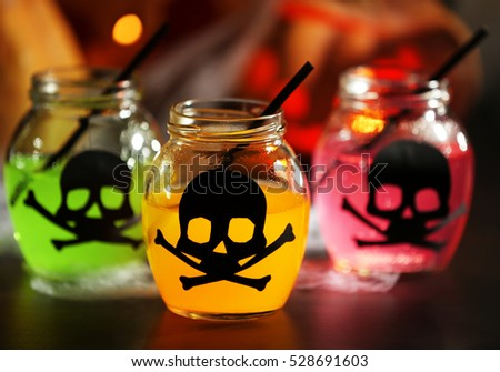 Close up view of tasty cocktails with decor for Halloween, on blurred background