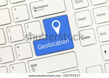 Close-up view on white conceptual keyboard - Geolocation (blue key)