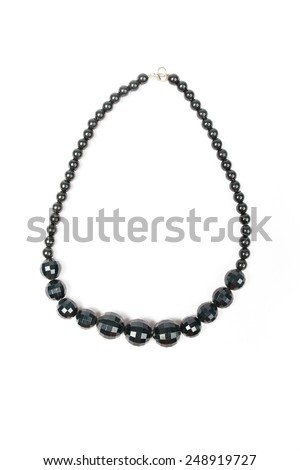 Close up with a black necklace isolated.