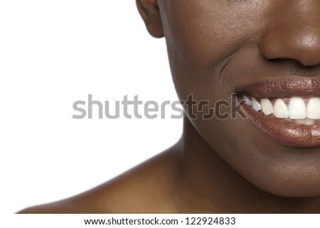 Close-up woman's mouth over the white background