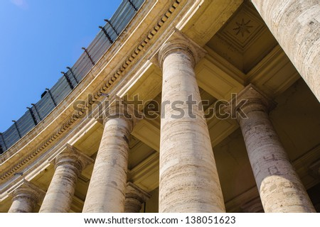 Close view of the columns of the Saint Peter's square in Vatican, Rome, Italy