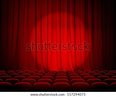closed theater red curtains with spotlight and seats