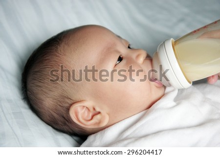 closed up of infant milk feeding
