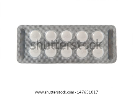 Closed up plain white tablet in transparent blister pack