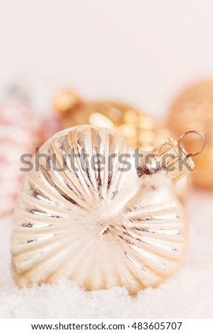 Closeup antique style glass Christmas decorations on snow background. Shallow focus