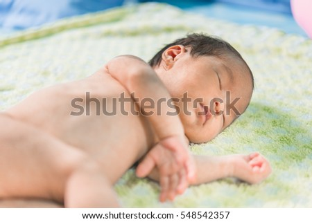 Closeup asian baby sleep on daylight