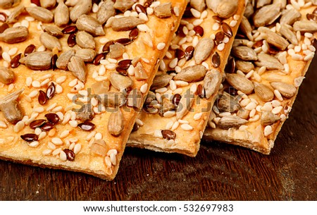 Closeup cereal cookies with seeds on a wooden table