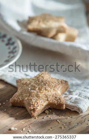closeup, delicious shortbread  and cup of tea placed on a napkin on a wooden table