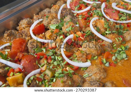 Closeup detail of a beef kofta curry on display at an indian restaurant