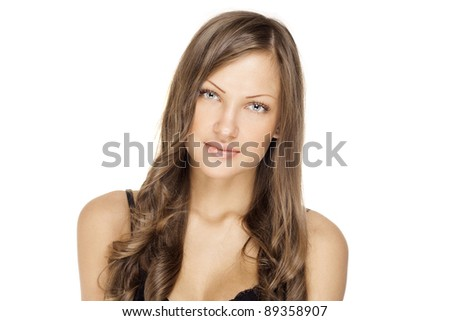 closeup fashion portrait of a beautiful young woman with curly hair