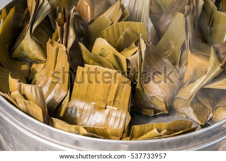 Closeup food wrapped in banana leaves in steam pot, Traditional Thai style