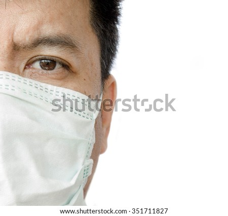 Closeup half face of a doctor wearing medical mask